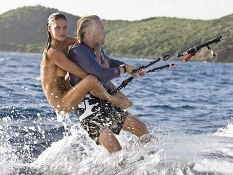 Richard Branson with a supermodel on his back