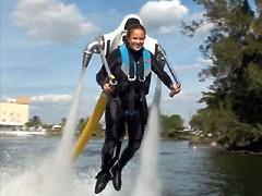 Girl using the Jetlev jet pack