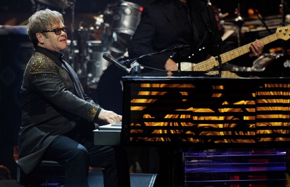 Elton John is all smiles after dropping $1 million on a new piano