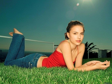 Natalie Portman rolling in grass for a photo shoot