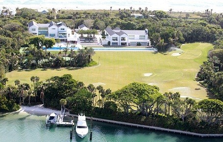Tiger Woods private golf course, boat dock and yacht behind his Jupiter Island home in Florida.
