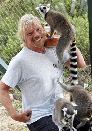 Richard Branson and a ring-tailed lemur.
