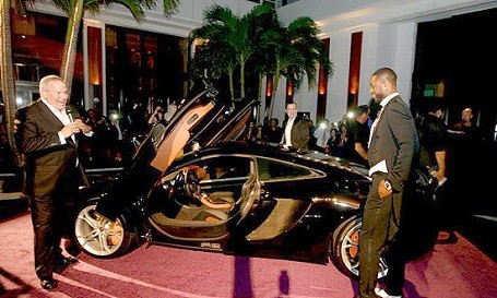 Dwyane Wade and his new McLaren MP4-12C supercar.