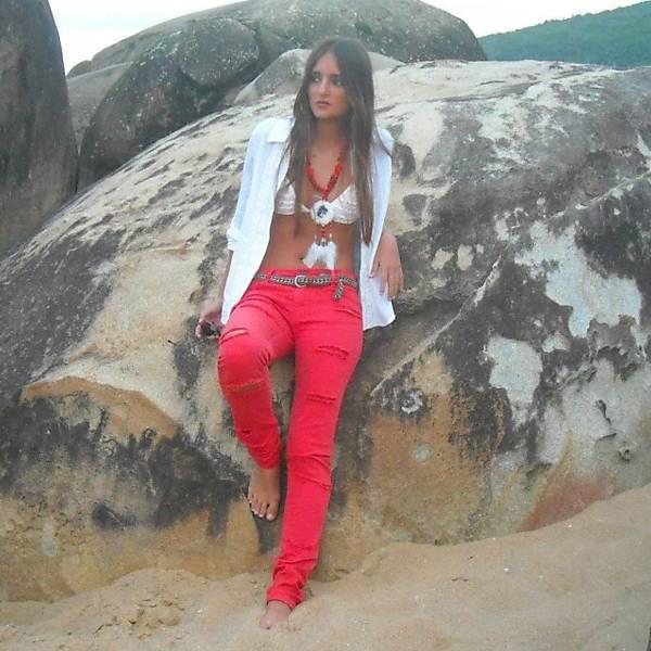 Brazilian Girl sitting on a rock