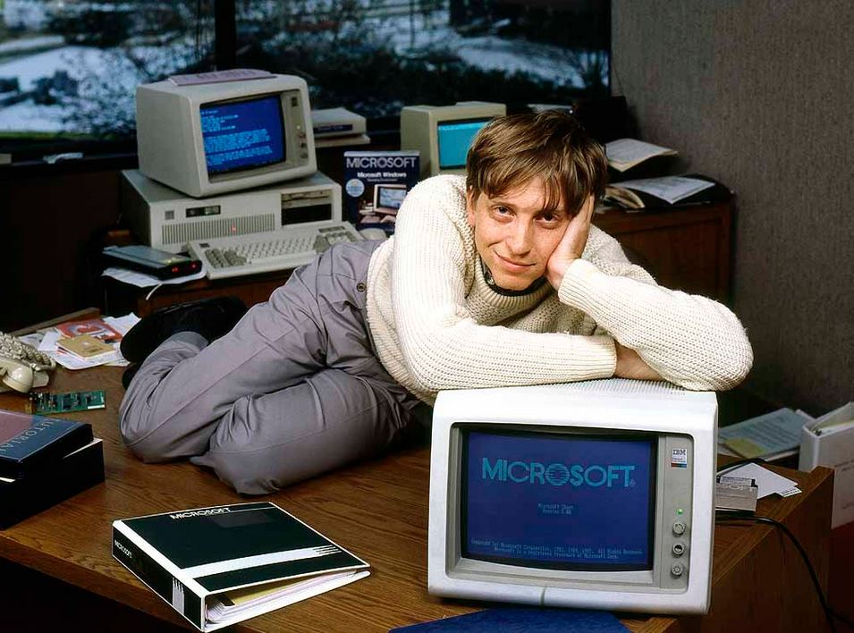 Bill Gates laying on desk