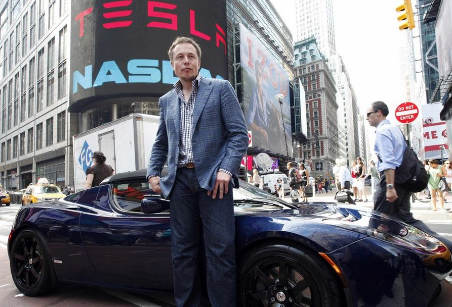 Elon Musk with a Tesla car