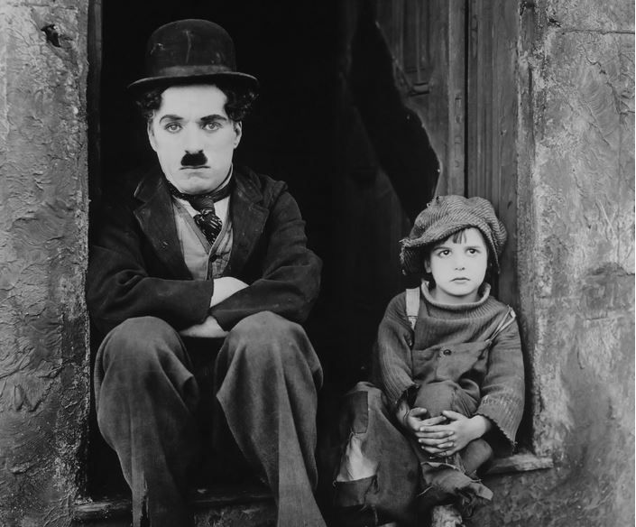 "Charlie Chaplin and Jackie Coogan in ""The Kid"""