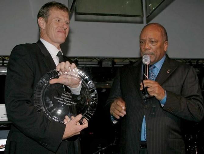 Receiving an Award from Quincy Jones