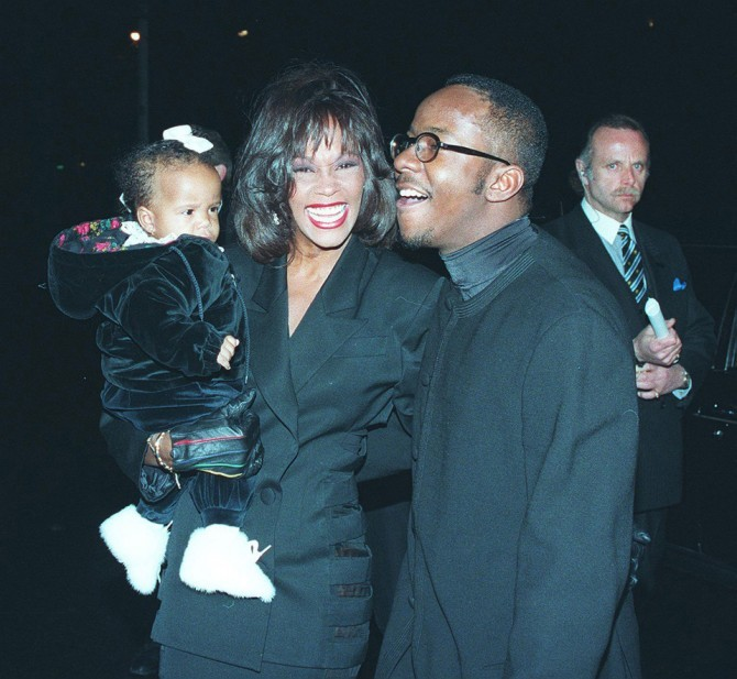 Whitney Houston, Bobby Brown and daughter, Bobbi Kristin, at Bobby's 25th birthday in NYC