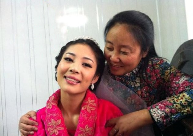 "Pic shows: The former millionaire who has fostered 75 kids. A businesswoman who became a millionaire through investments in coal mining is now hundreds of thousands of pounds in debt after having spent everything on adopting 75 orphans over the past two decades. Li Lijuan, a native of Wu'an County in northern China's Hebei Province, ran a garment business and eventually became a millionaire after successful investments in a coal mine in the 1980s. Lijuan, 46, adopted her first orphan in 1994 - a boy from the south-western province of Sichuan. And since then, she has adopted dozens more, all children who were abandoned because of illness or disabilities, or orphaned because of natural disasters and other misfortunes. Over the past 19 years, 75 children have been fostered by Lijuan, who began eating into her savings in 2008 after the coal mine she invested in shut down for urban planning purposes. She is now some 2 million RMB (200,000 GBP) in debt. Despite her financial difficulties, Lijuan has continued to raise her foster children, sometimes accommodating more than 20 at once. To do this, she has sold her properties as well as other valuables that she possessed. Lijuan also receives donations from charities, but the costs of raising her children, many of whom require extensive operations for disabilities and other birth defects, far outweigh the money she receives. She continues to send children to school in hope that education and knowledge may change their fates. Some of her foster children have gone on to receive university degrees and gain the most coveted work available in China as public servants. But Lijuan's task was made even more difficult when, in 2011, she was diagnosed with early-stage lymphoma, for which she spent a week in hospital receiving treatment. She has always maintained that she could have used the medical expenses of her treatment on the children, who see her as their ""mother"". In spite of raising dozens of children over the"