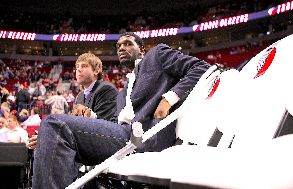 PORTLAND, OR - OCTOBER 10: Greg Oden #52 of the Portland Trail Blazers, who is out for the season after under going micro fracture surgery in his knee, sits on the bench to watch a pre-season game against the Los Angeles Clippers at the Rose Garden on October 10, 2007 in Portland, Oregon. Jonathan Ferrey/Getty Images).
