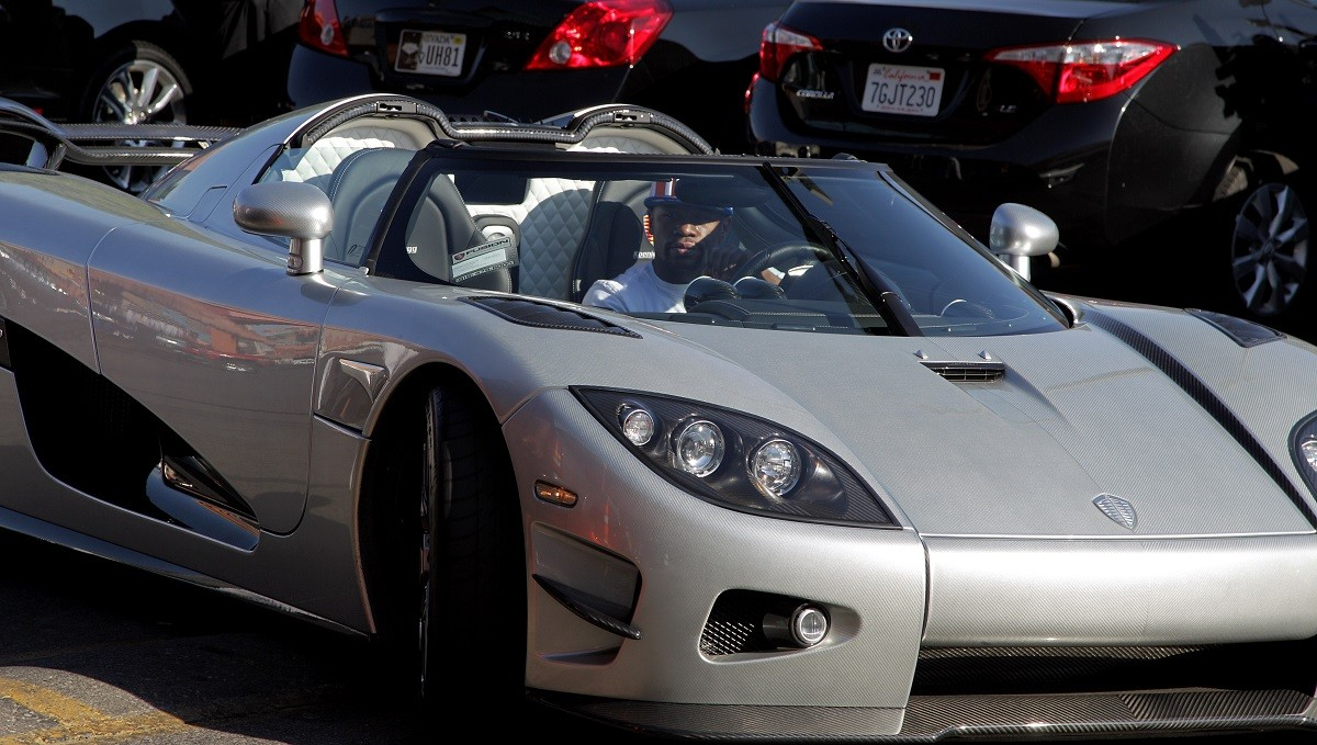 Floyd Mayweather Jr. arrives at the Mayweather Boxing Club in his new $4.8 million Koenigsegg CCXR Trevita car for a workout on August 26, 2015 in Las Vegas. Mayweather will meet Andre Berto in a welterweight title bout September 12, 2015, at the MGM Grand Garden Arena in Las Vegas. AFP PHOTO/JOHN GURZINSKI (Photo credit should read JOHN GURZINSKI/AFP/Getty Images)