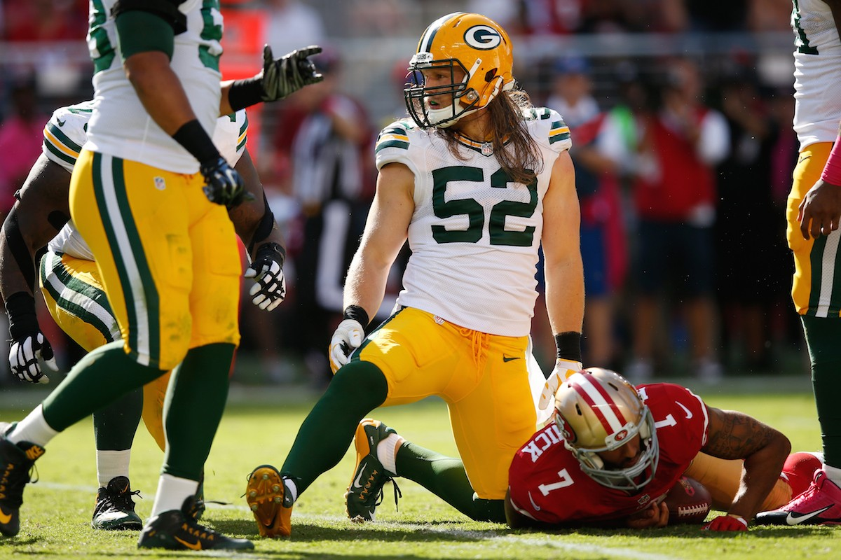 SANTA CLARA, CA - OCTOBER 04: Inside linebacker Clay Matthews #52 of the Green Bay Packers kneels on the field after sacking quarterback Colin Kaepernick #7 of the San Francisco 49ers during their NFL game at Levi's Stadium on October 4, 2015 in Santa Clara, California. (Photo by Ezra Shaw/Getty Images)