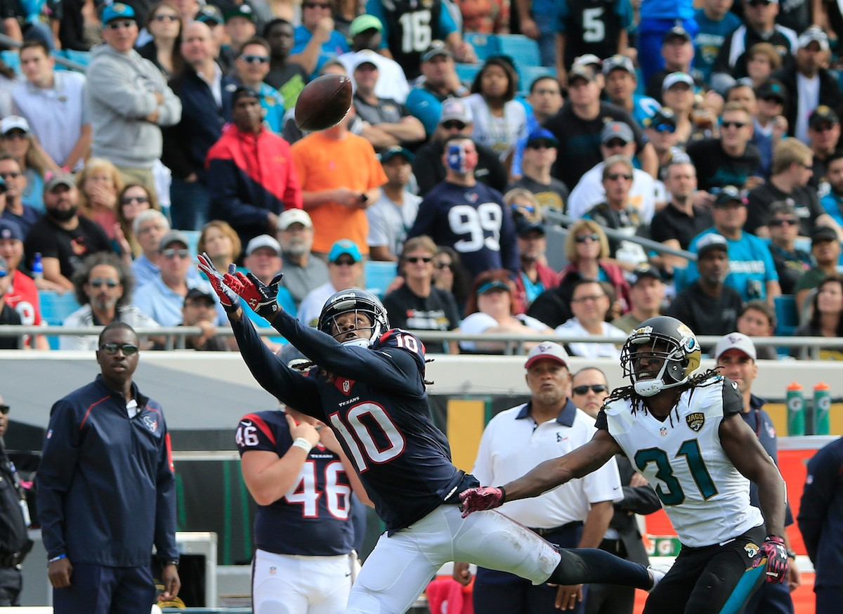 JACKSONVILLE, FL - OCTOBER 18: DeAndre Hopkins #10 of the Houston Texans attempts a reception against Davon House #31 of the Jacksonville Jaguars during the game at EverBank Field on October 18, 2015 in Jacksonville, Florida. (Photo by Sam Greenwood/Getty Images)