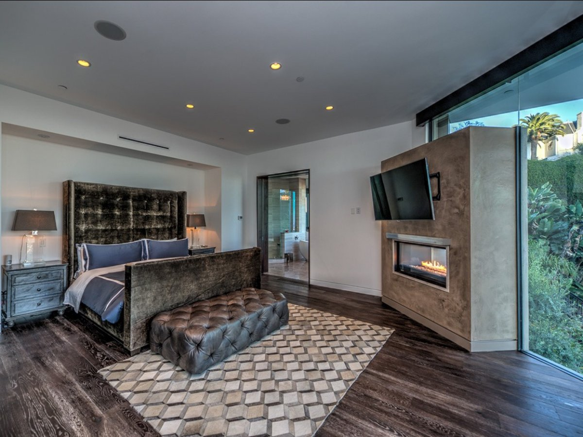on-the-second-floor-the-master-bedroom-has-a-luxurious-fireplace-and-space-for-a-gigantic-bed