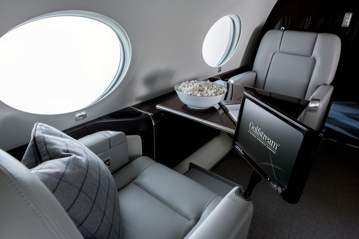 the-cabin-features-tables-along-with-12-portholes-that-let-in-as-much-light-as-possible-gulfstream-actually-advertises-the-jet-as-being-bright-and-airy