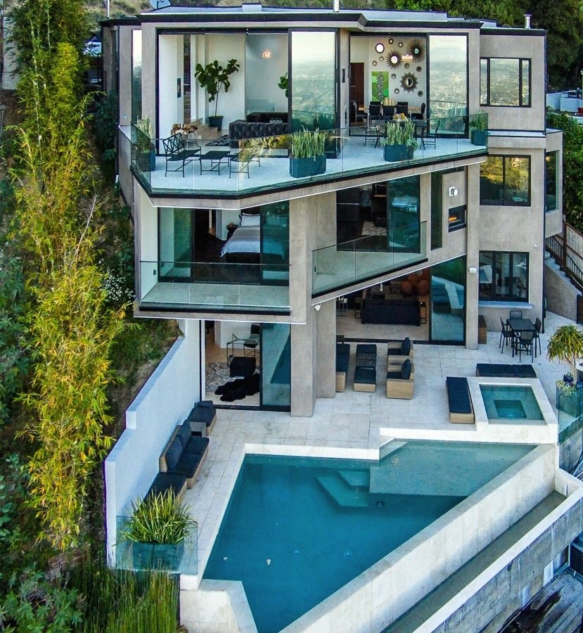 the-home-has-three-stories-each-with-its-own-set-of-balconies
