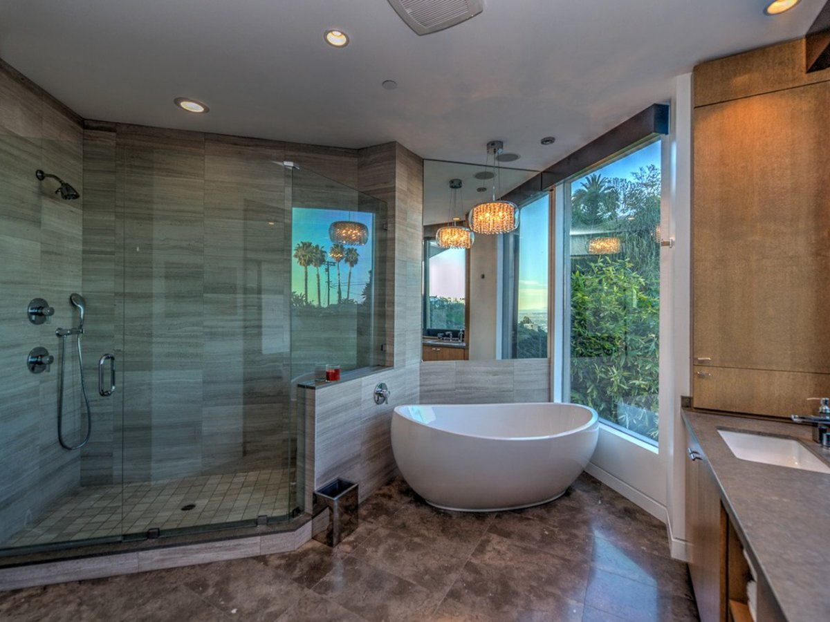 the-master-bath-has-a-standalone-tub-and-a-large-shower