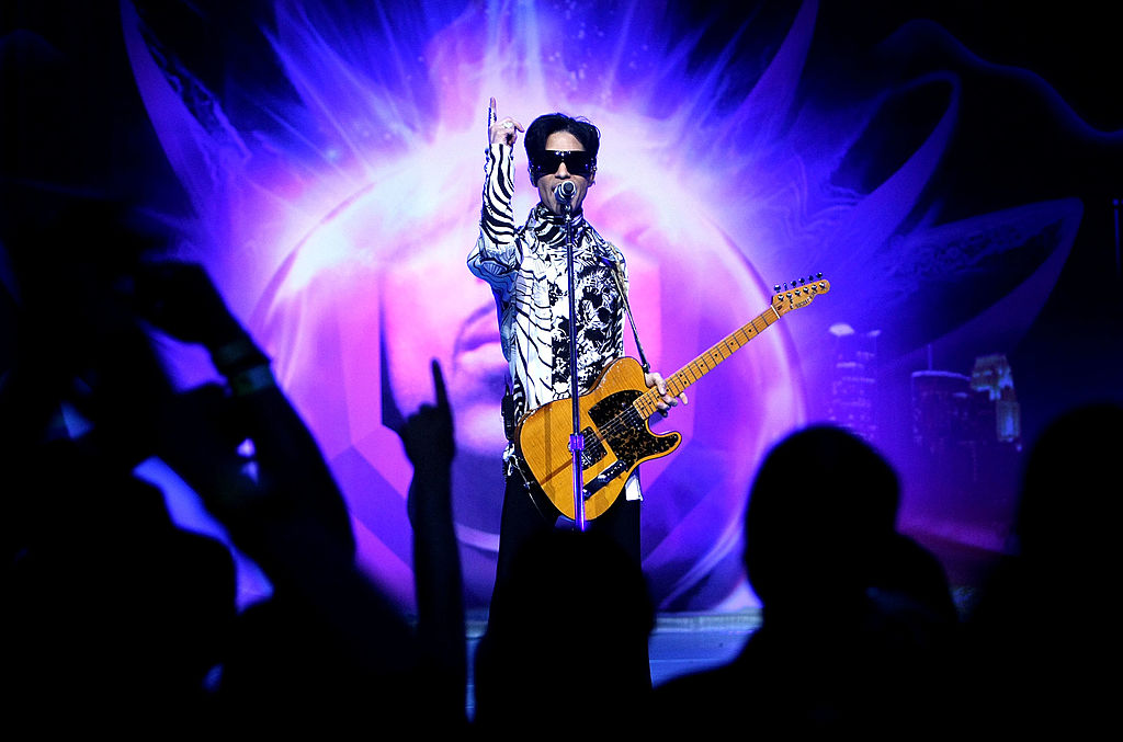 "LOS ANGELES, CA - MARCH 28: ***EXCLUSIVE*** Musician Prince performs his first of three shows onstage during ""One Night... Three Venues"" hosted by Prince and Lotusflow3r.com held at NOKIA Theatre L.A. LIVE on March 28, 2009 in Los Angeles, California. (Photo by Kristian Dowling/Getty Images for Lotusflow3r.com)"
