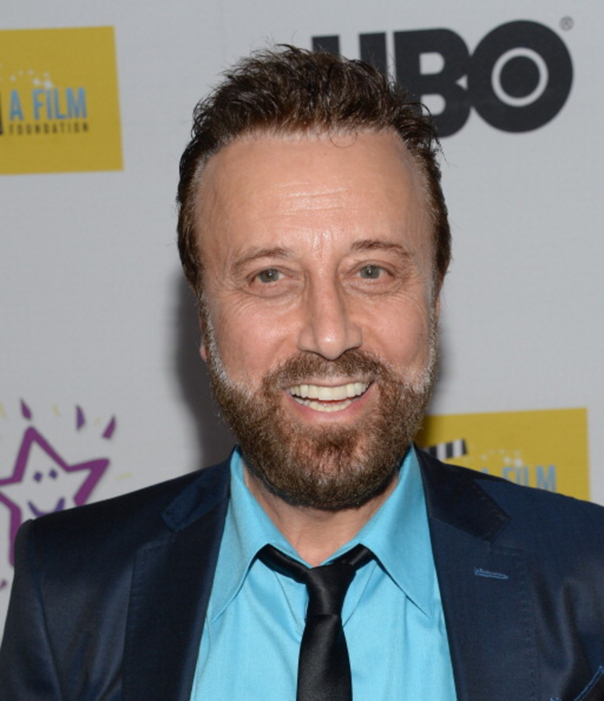 The 70-year old son of father (?) and mother(?) Yakov Smirnoff in 2021 photo. Yakov Smirnoff earned a  million dollar salary - leaving the net worth at  million in 2021