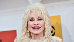 Thumbnail for Dolly Parton: Big Hair, Big Voice, Big Shoes… Ginormous Bank Account.