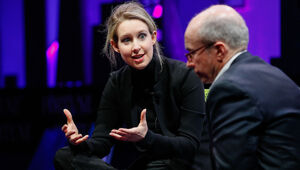 Thumbnail for Is Elizabeth Holmes A Genius Or A Con Artist?