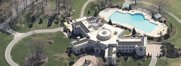 The Up And Down History Of Evander Holyfield's Unbelievable Former Mansion (Current Owner: Rick Ross)