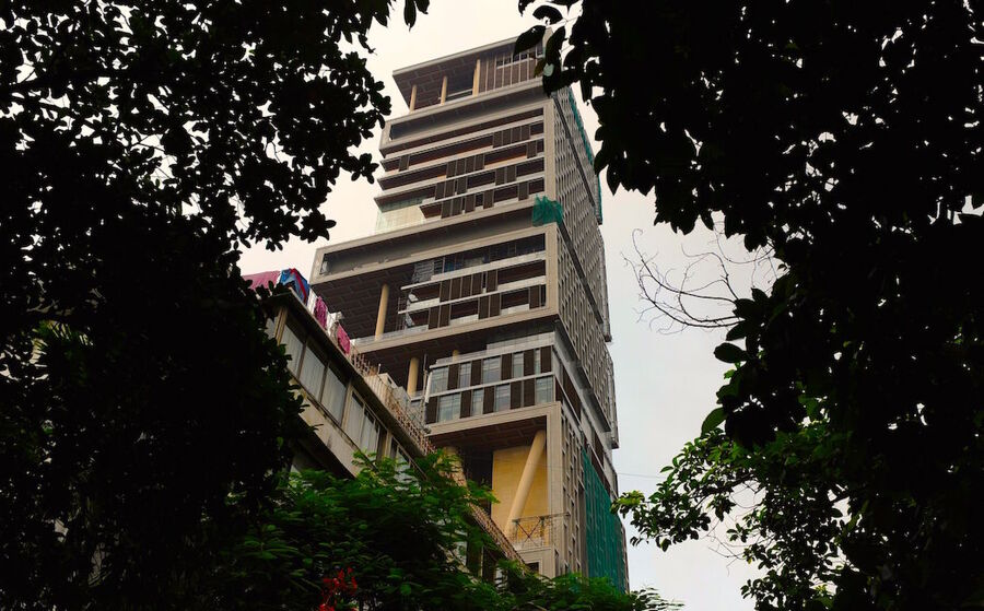 The twenty-seven story Antilia, the newly-built residence of Reliance Industries chairman Mukesh Ambani, is seen in Mumbai on October 19, 2010. The 400,000 square foot residence, named after a mythical island in the Atlantic, is expected to be occupied by Ambani, his wife and three children later in the year. The building has three helicopter pads, underground parking for 160 cars, and requires some 600 staff to run. INDRANIL MUKHERJEE/AFP/Getty Images.