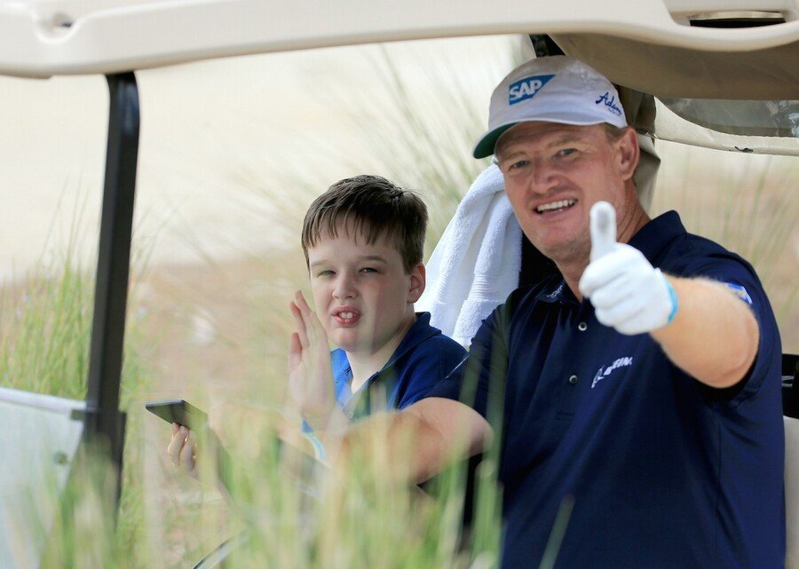 WEST PALM BEACH, FL - MARCH 09: Ernie Els of South Africa with his son Ben during the Ernie Els Els for Autism pro-am on March 9, 2015 in West Palm Beach, Florida. David Cannon/Getty Images.