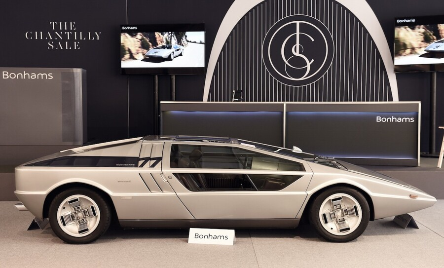 """A """"Maserati Boomerang coupe"""" from 1972 is displayed on September 4, 2015, in Chantilly, prior to the Bonhams vintage cars auction sale. AFP PHOTO / ERIC FEFERBERG"""