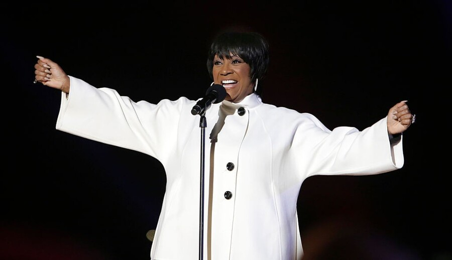 WASHINGTON, DC - DECEMBER 04: Singer Patti LaBelle performs during the lighting of the National Christmas tree with first lady Michelle Obama on December 4, 2014 in Washington, DC. The tree lighting ceremony marks a month-long series of holiday events in President's Park at The White House. (Photo by Chris Kleponis-Pool/Getty Images)