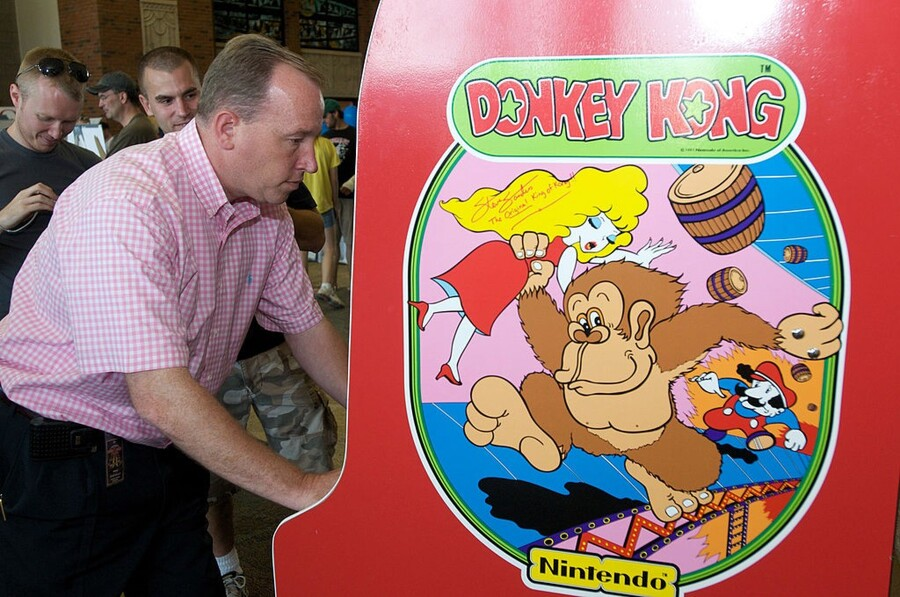 OTTUMWA, IA - AUGUST 13: Steve Sanders, 'The Orignal King of Kong,' plays Donkey Kong at the launch party for the International Video Game Hall of Fame and Museum on August 13, 2009 in Ottumwa, Iowa. Ottumwa was officially proclaimed the Video Game Capital of the World at the launch party and plans are underway to build a full museum in the small Iowa city. (Photo by David Greedy/Getty Images)