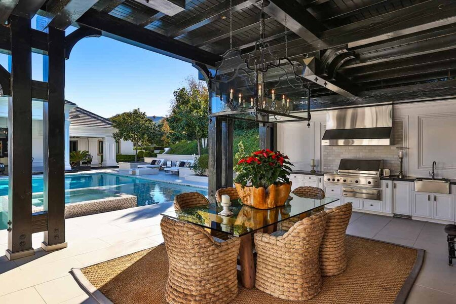 the-living-room-is-open-to-the-pool-area-creating-a-seamless-flow-between-indoor-and-outdoor-space-for-easy-entertaining