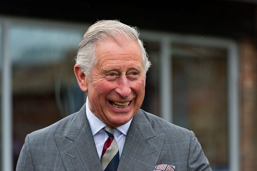 DORCHESTER, UNITED KINGDOM - MAY 08: Prince Charles, Prince of Wales meets residents of The Guinness Partnership's 250th affordable home in Poundbury on May 8, 2015 in Dorchester, Dorset. (Photo by Ben A. Pruchnie - WPA Pool Getty Images)