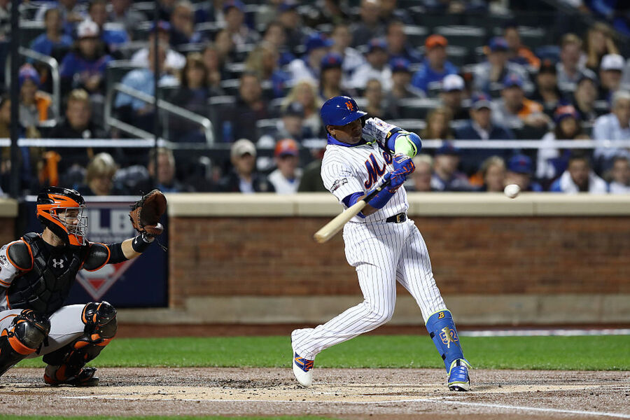 NEW YORK, NY - OCTOBER 05: Yoenis Cespedes #52 of the New York Mets bats against the San Francisco Giants in the first inning during their National League Wild Card game at Citi Field on October 5, 2016 in New York City. (Photo by Elsa/Getty Images)