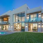 John Legend And Chrissy Teigen Buy Rhianna's Former House For $14.1 Million