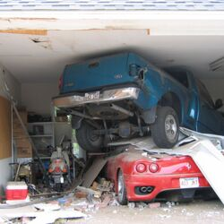 Caption Contest: Ferrari Vs. Truck in Garage