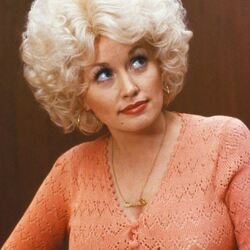 Dolly Parton: Big Hair, Big Voice, Big Shoes... Ginormous Bank Account.
