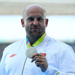 A Polish Olympian Just Auctioned Off His Silver Medal For A Great Cause