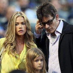 Denise Richards Says Charlie Sheen Owes Her $450,000 In Child Support