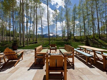 Patio with a view of the rocky mountains behind Jerry Seinfeld's Colorado vacation home.
