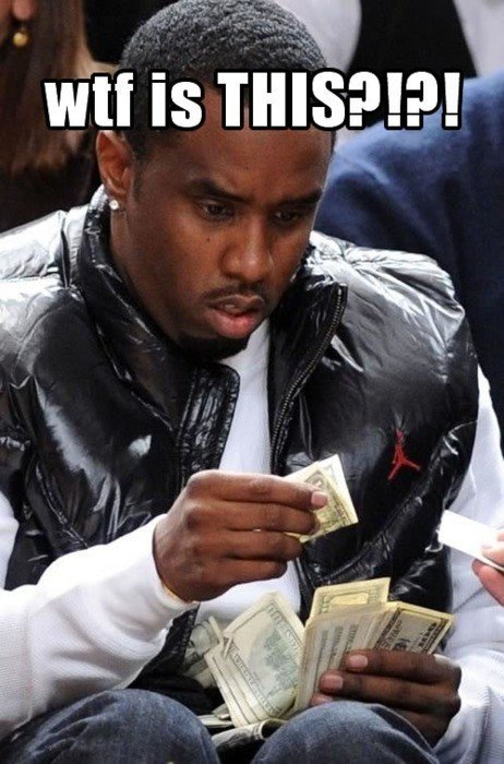 Puff Daddy is confused by a dollar bill