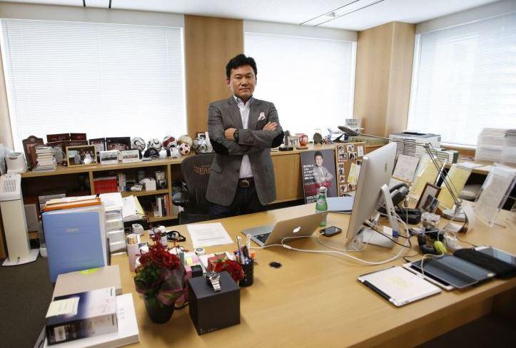 Hiroshi Mikitani in his Office