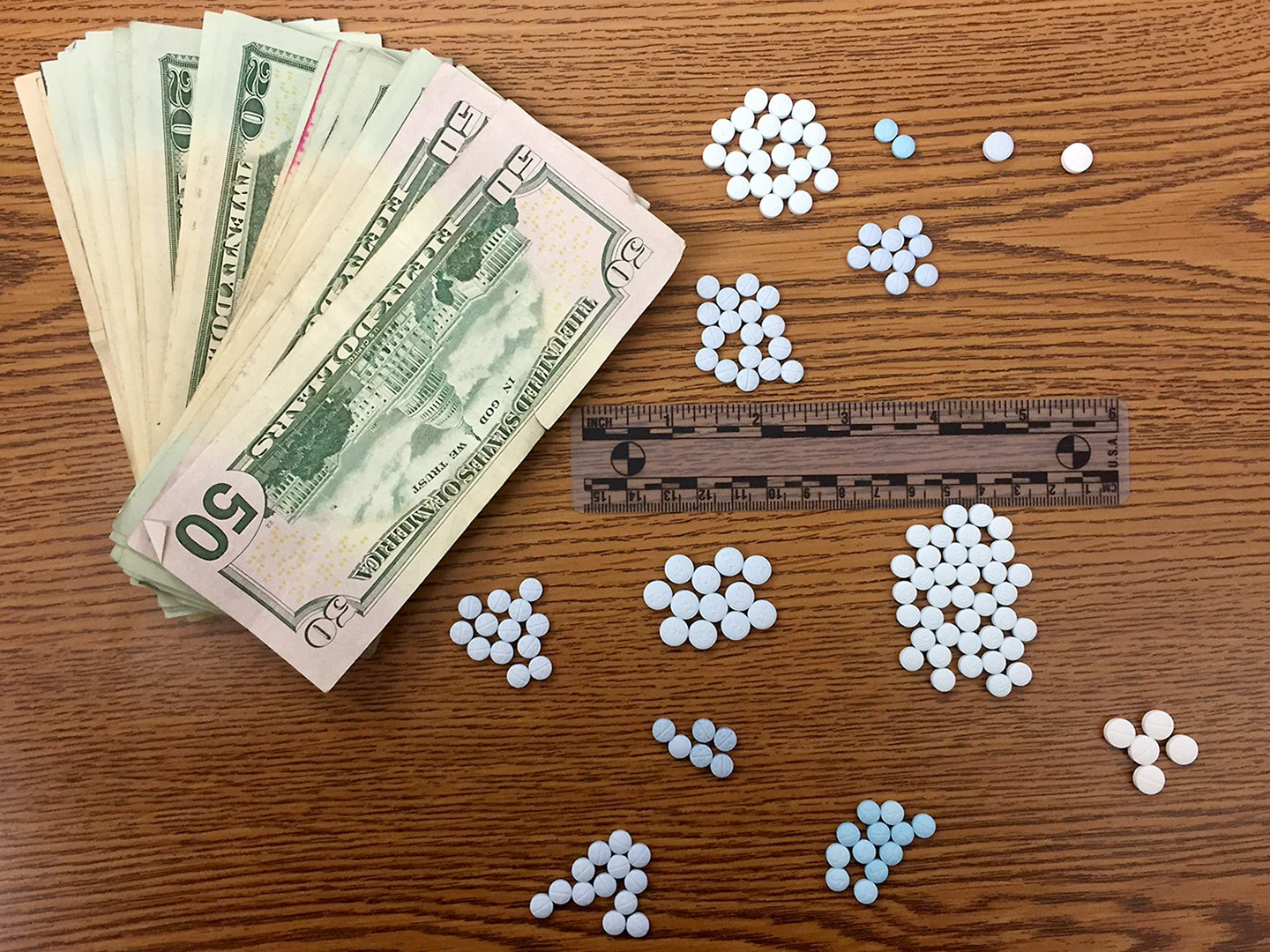 Police displayed cash and money seized from two men arrested on drug charges Friday.