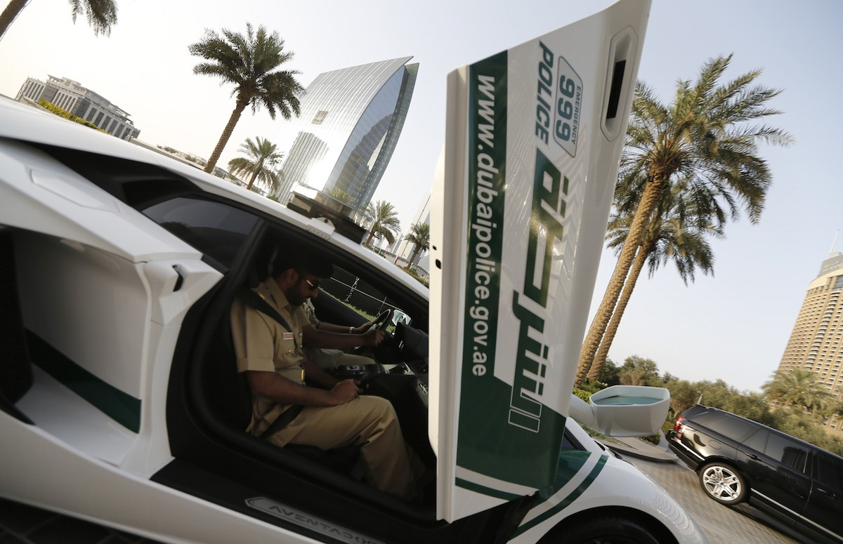 Emirati policemen patrol in an especially modified Lamborghini Aventador on April 16, 2013 in the Gulf emirate of Dubai. The introduction of the sports car, which can reach speeds of up to 349 km/h (217 mph), aims to make justice quicker on Dubai's dangerous highways. AFP PHOTO/KARIM SAHIB (Photo credit should read KARIM SAHIB/AFP/Getty Images)