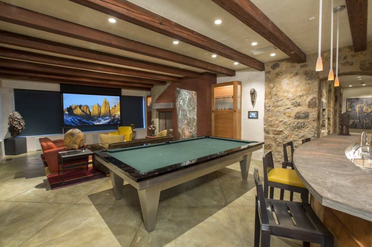 with-a-pool-table-wet-bar-and-large-projection-screen-this-room-is-ready-for-entertaining