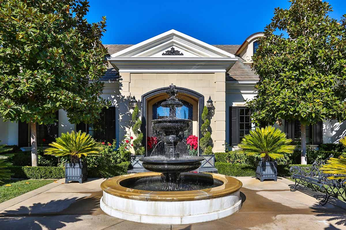 the-five-bedroom-single-level-estate-has-a-dramatic-stone-entrance-with-a-courtyard-complete-with-fountain