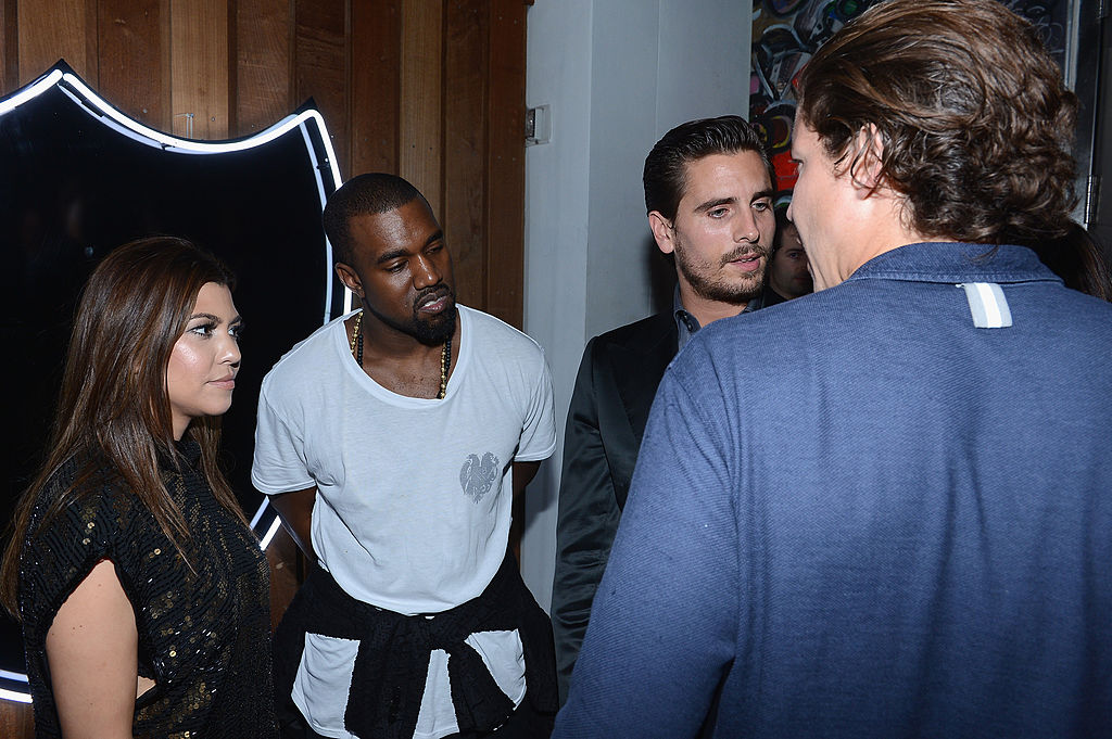 MIAMI BEACH, FL - DECEMBER 06: Kourtney Kardashian and Kanye West and Scott Disick attend the celebration of Dom Perignon Luminous Rose at Wall at W Hotel on December 6, 2012 in Miami Beach, Florida. (Photo by Dimitrios Kambouris/Getty Images for Dom Perignon)