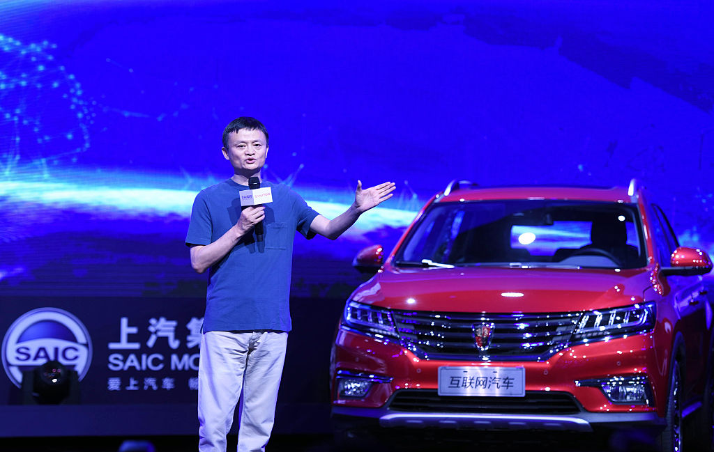 This photo taken on July 6, 2016 shows Jack Ma, Alibaba's founder and chairman, speaking during a launch event for the Roewe RX5 car in Hangzhou, in eastern China's Zhejiang province. E-commerce giant Alibaba and SAIC Motor launched a new internet-enabled vehicle, equipped with the e-commerce giant's YunOS operating system on July 6. / AFP / STR / China OUT (Photo credit should read STR/AFP/Getty Images)